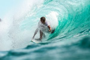 surfer in wave - Electric Vehicle subsidies