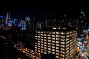 Night view of midtown Manhattan office and apartment towers.